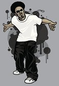 Vector illustration of a young, male, urban hip-hop model posing with knees slightly bent and arms behind his back. Model is wearing a white tshirt, baggy black pants, white ball cap and silver medallion necklace, posing in front of graffiti design elements in the background. Necklace is grouped so that it can easily be removed. File is made with minimal global color swatches. Model and design elements are on separate layers.