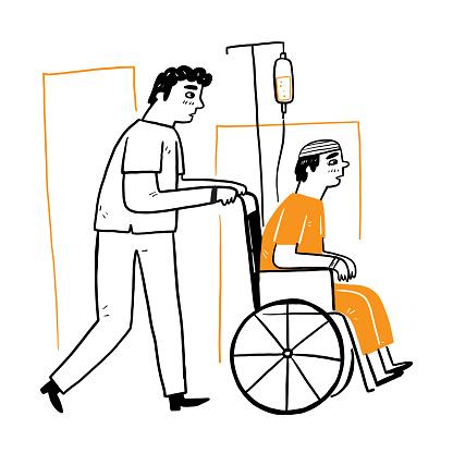 Male nurses help patients push wheelchair
