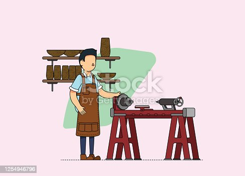 istock Male woodworker working at the workshop with a lathe. 1254946796