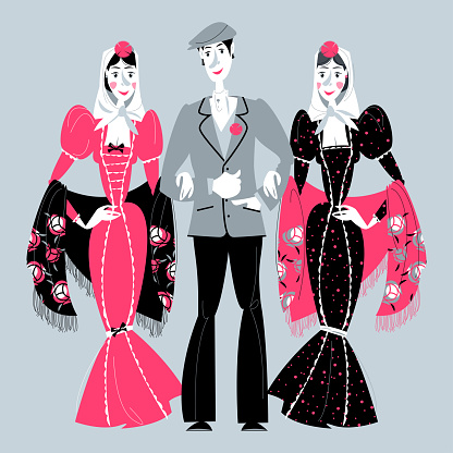 """Man and two women in traditional clothes during the festival of """"San Isidro"""" (Fiestas de San Isidro), patron of Madrid."""