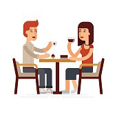Man and woman drinking coffee in a cafe