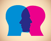 Vector illustration of a man and woman's blue and pink faces overlapping against a tan background.