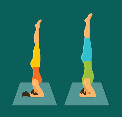 man and woman headstand pose couple practicing yoga