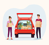 Man and woman hold boxes. Moving house. Things in box in the trunk of the car on the back.  Vector flat style illustration