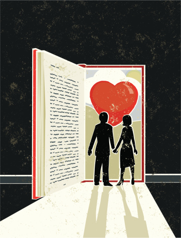 Man and Woman looking at a Love Story Book
