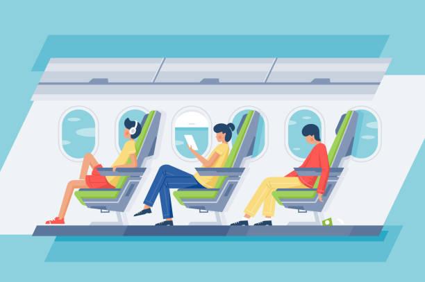 mann und frau passagier mit kopfhörer und buch entspannen sie sich in der ebene. - fahrzeugsitz stock-grafiken, -clipart, -cartoons und -symbole