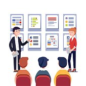 Man and woman presenting their project business plan. Showing data, explaining charts on cards. Business presentation, training or seminar. Flat style vector illustration isolated on white background.