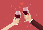 Man and woman toasting a wine glasses. Romantic moment