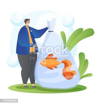 istock Man buy cute fish marine pets in domestic store 1323865952