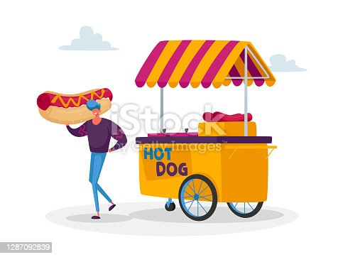 istock Man Buy Street Food, Takeaway Junk Meal from Wheeled Cafe or Food Truck. Tiny Male Character with Huge Hot Dog at Booth 1287092839