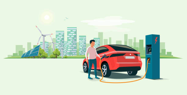 Man Charging an Electric Car Suv in the Eco City Modern electric suv car charging at the charger station with a young man holding the cable. Wind turbines and solar panels with urban landscape in background. Flat vector illustration concept. electric vehicle charging station stock illustrations