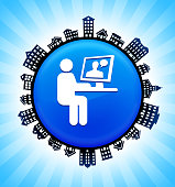 Man Chating on Computer on Rural Cityscape Skyline Background. The button is in the center of the illustration. a detailed 100% vector rural cityscape skyline is placed around the circumference of the button and includes various houses, single family homes, residential condominium and other suburb buildings. There is a blue sky background with a star burst glow rendered behind the buildings. The image is ideal for displaying rural suburban life concepts and ideas.