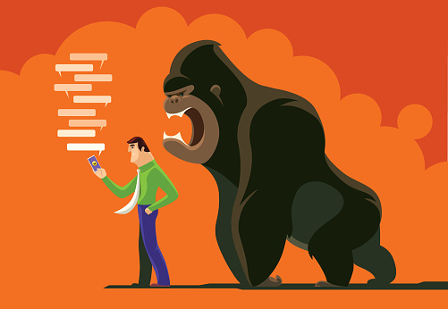 man checking smartphone with angry gorilla
