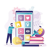 istock Man constructs app interface. Team creates custom design for mobile application. Different applications icons on smartphone screen 1344434991