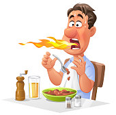 Man Eating Hot And Spicy Food