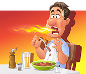 Vector illustration of man sweating and breathing fire while eating a hot and spicy meal. Perfect for a hot or spicy food illustration.