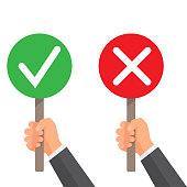 Man hand hold signboard green check mark and red X