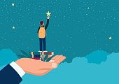 istock Man hand lifting up a school boy to reach for the star 1291423053