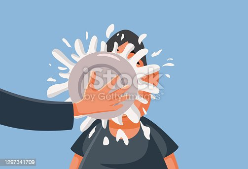 istock Man Having Pie Thrown in his Face as a Prank 1297341709