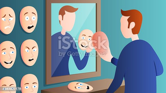istock Man holding mask, feeling confused and with multiple personalities, 1283022178