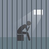 man in dark prison