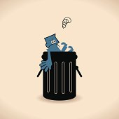 istock Man in Garbage Bin 165975392