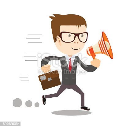 istock Man in suit shouting through a loudspeaker. 629626054