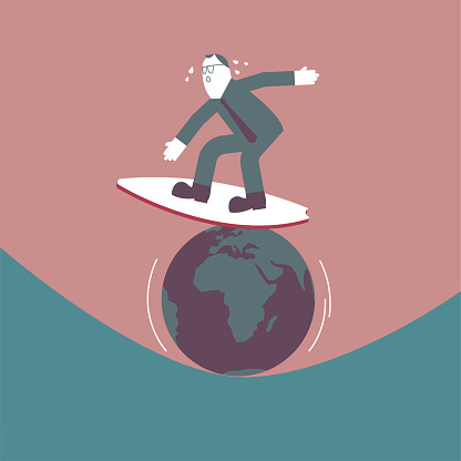 A man is surfing on the earth.