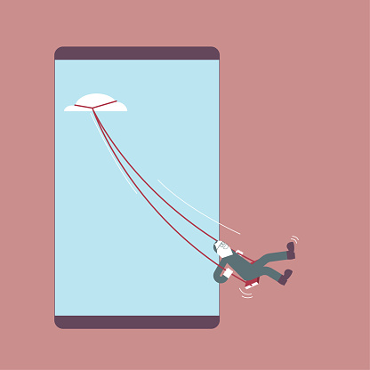 A man is swinging on a cell phone.