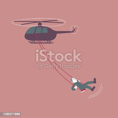 A man is swinging on a helicopter. The background is brown.