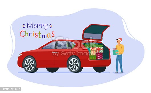 istock Man loading christmas gifts into the trunk of a car. Vector flat style illustration. 1285091427