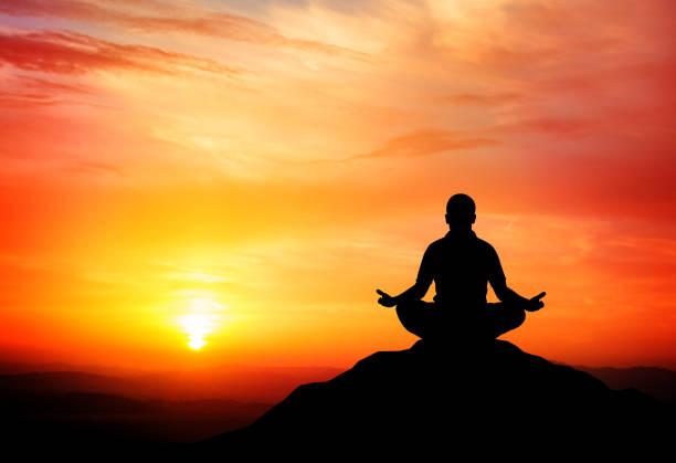 bildbanksillustrationer, clip art samt tecknat material och ikoner med man meditates on beautiful mountain dusk. - buddhism