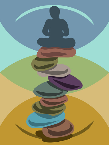 a man meditating in lotus pose on stack of nine zen stones