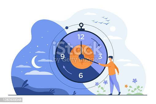 istock Man moving clock arrows and managing time 1282639348