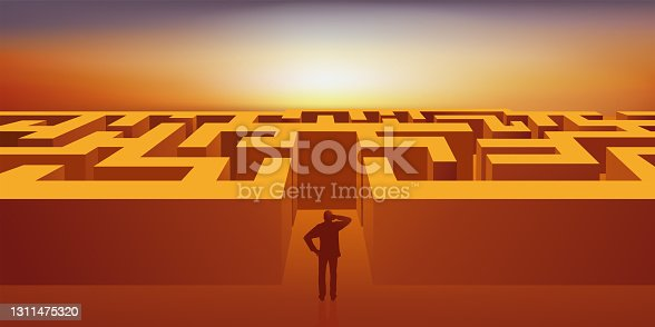 istock A man must find the way out of a maze. 1311475320