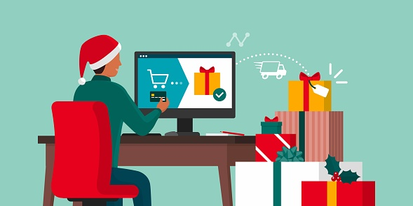 Man ordering Christmas gifts online