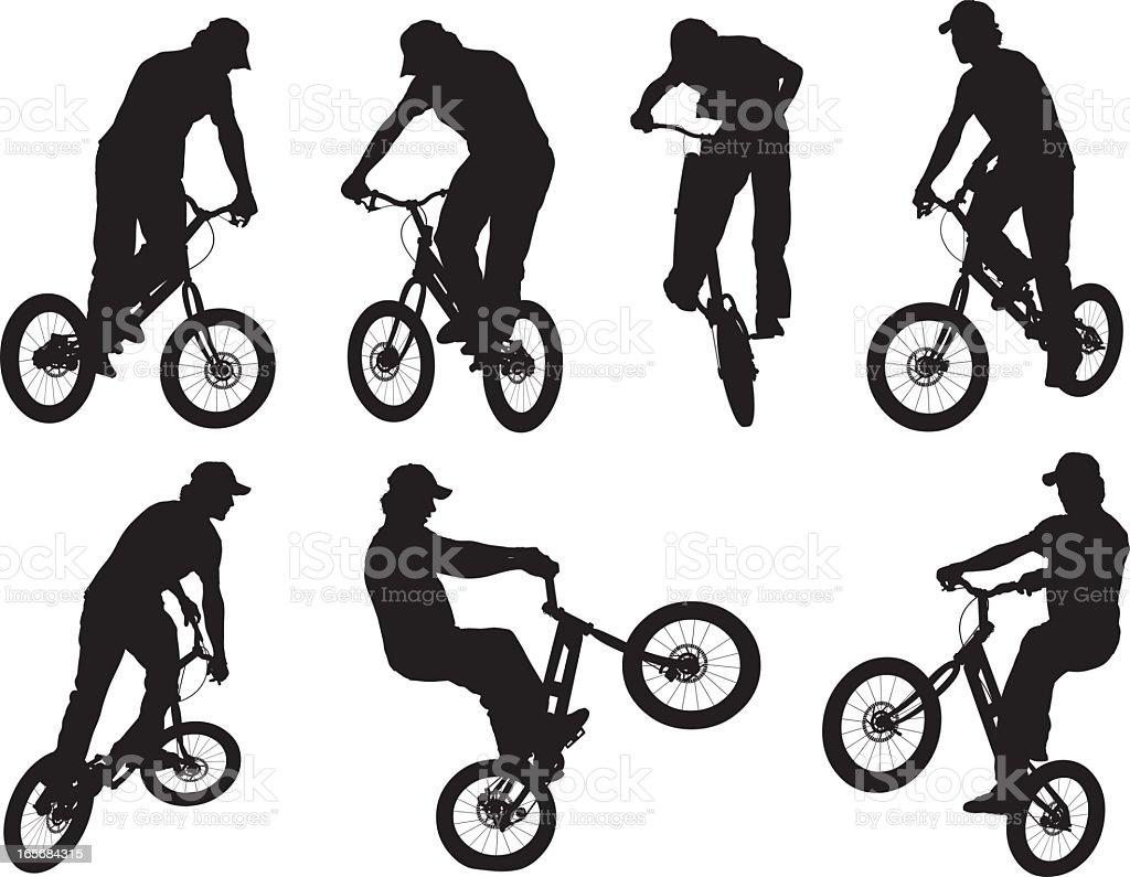 Man performing stunts on a BMX bike vector art illustration
