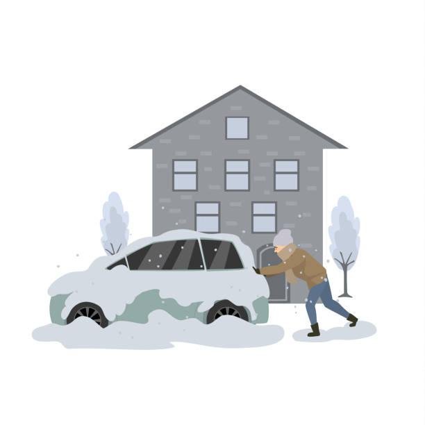 mann schiebt die stecken in schnee und eis auto während blizzard - feststecken stock-grafiken, -clipart, -cartoons und -symbole