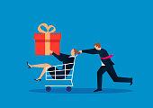 Man pushing shopping cart, woman holding gift box