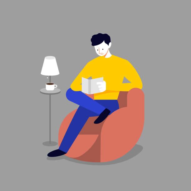 남자는 소파와 읽기 책에 긴장 - reading stock illustrations