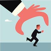 Man running away from big hand