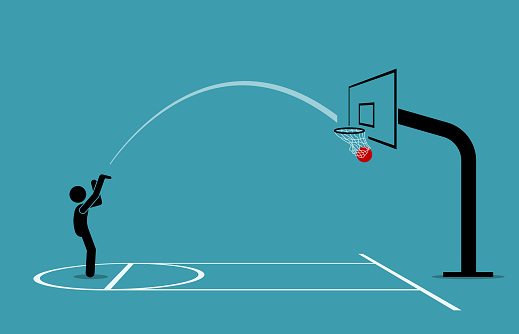 Man shooting a basketball into a hoop and scoring from free throw line.