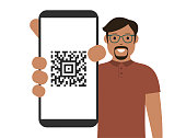 istock Man showing a smart phone screen with QR code. Cartoon vector stock illustration 1291787452