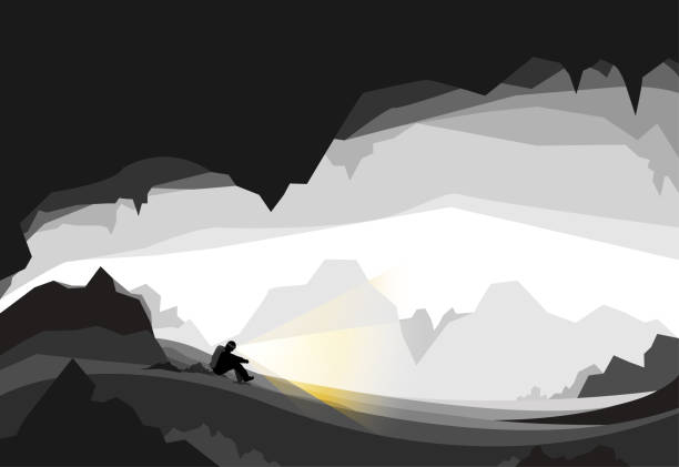 man sitting desperate lost in cave - lost stock illustrations