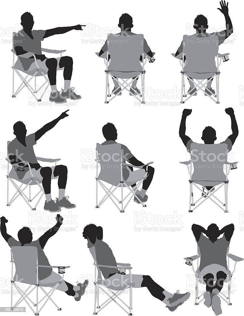 Man sitting on folding chair vector art illustration