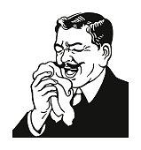Man Sneezing into a Handkerchief