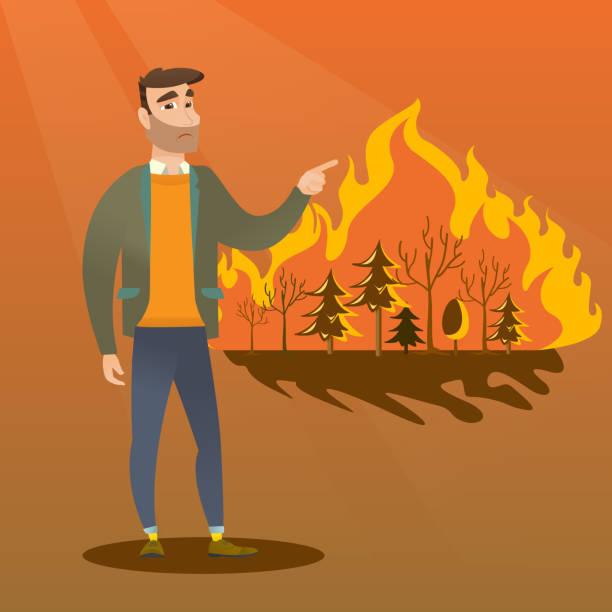 bildbanksillustrationer, clip art samt tecknat material och ikoner med man står på bakgrunden av wildfire - skog brand
