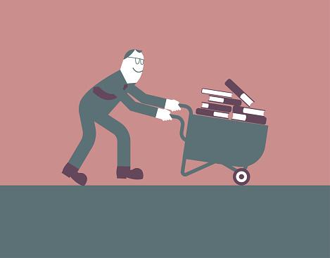 A man transports the books using a wheelbarrow.