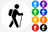 Man Travel With The Walking Stick.The icon is black and is placed on a round blue vector button. The button is flat white color and the background is light. The composition is simple and elegant. The vector icon is the most prominent part if this illustration. There are eight alternate button variations on the right side of the image. The alternate colors are orange, red, purple, yellow, black, green, blue and indigo.