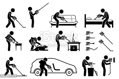 istock Man using handheld cordless stick vacuum cleaner to clean the house. 1247895559